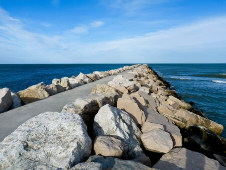 Stone bridge that leads into the sea