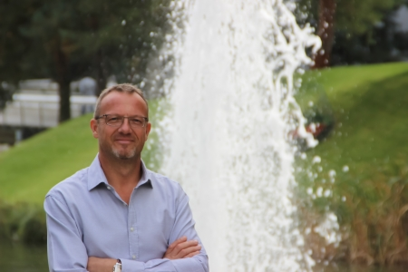 Elderly man in front of a fountain Stock Photo