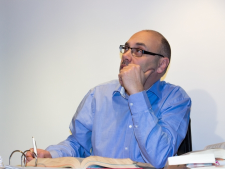 Pensive man at desk Stock Photo