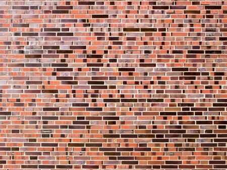 Marrone muro di mattoni rossi Archivio Fotografico