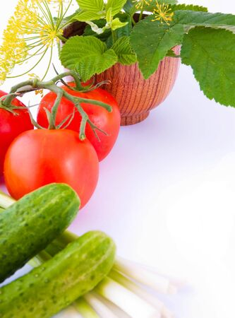 Still-life from a tomato, a cucumber, and onions with a flower and green leaves Stock Photo - 10009834