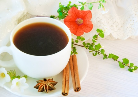 The French breakfast on lacy napkins, coffee and a flower photo