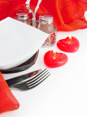 image date: Celebratory table layout with red napkins and candles in the form of heart