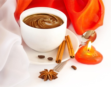 Cup of coffee with red and white napkins, a candle in the form of heart photo