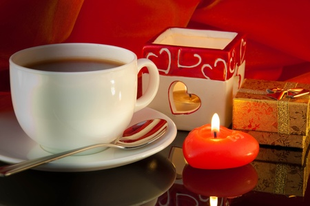 Cup of coffee and candle in the form of heart on a black background Stock Photo - 10637425