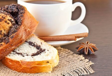 Cup of coffee and appetizing cake on a wood background photo