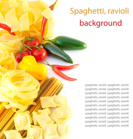 Spaghetti with red pepper, a basil and a tomato on a white background photo
