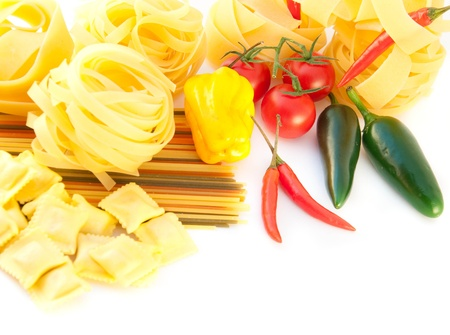 Spaghetti with red pepper, a basil and a tomato on a white background Stock Photo - 10825433