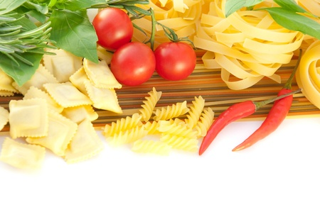 mediterranean cuisine: Spaghetti with red pepper, a basil and a tomato on a white background