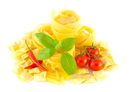 Spaghetti with red pepper, a basil and a tomato on a white background Stock Photo - 10825398