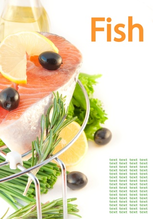 Salmon, a lemon and olives on a grill, fresh fish photo