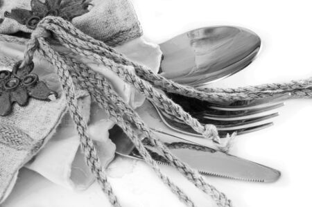 crockery: Table fork and knife in a napkin of medieval style Stock Photo