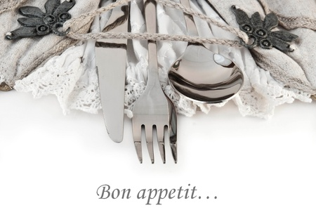 grunge silverware: Table fork and knife in a napkin of medieval style Stock Photo
