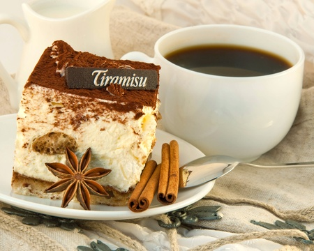layer cake: Cake tiramisu and a cup of hot coffee Stock Photo