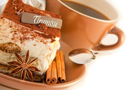 Cake tiramisu and a cup of hot coffee photo