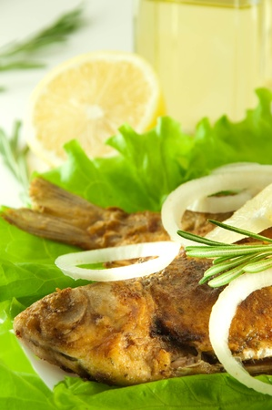 Fish fried, a crucian with a lemon, rosemary and olive oil Stock Photo - 11377054