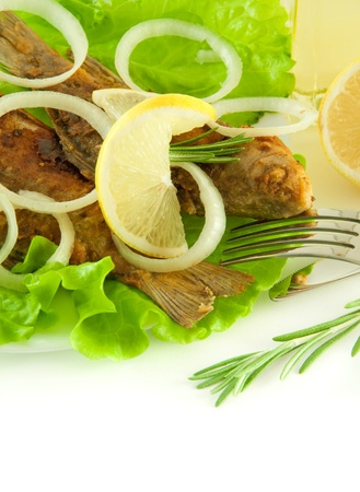 Fish fried, a crucian with a lemon, rosemary and olive oil Stock Photo - 11377052