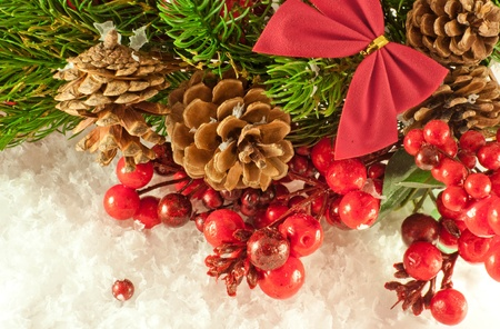 Christmas red tape and branch of berries and fur-tree Stock Photo - 11377176