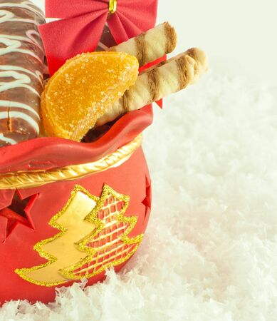 Christmas bag with gifts, cookies and fruit candy, a gift photo