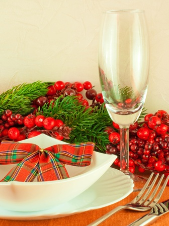 Christmas table layout, multi-colored tape with a branch of berries Stock Photo - 11377166