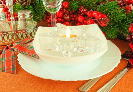 Centrepiece: Christmas table layout, multi-colored tape with a branch of berries Stock Photo