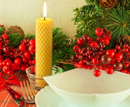 Christmas table layout, multi-colored tape with a branch of berries photo