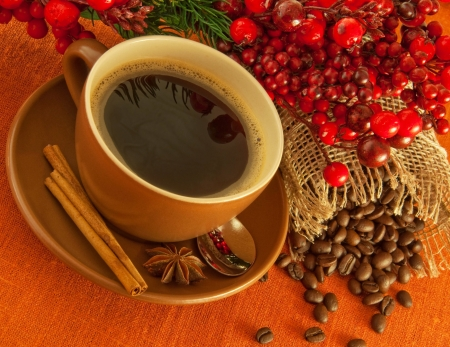 coffee tree: Christmas branch from berries and a fur-tree and a cup of coffee