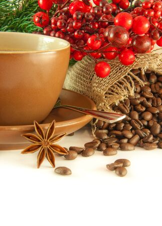 Christmas branch from berries and a fur-tree and a cup of coffee Stock Photo - 11377122