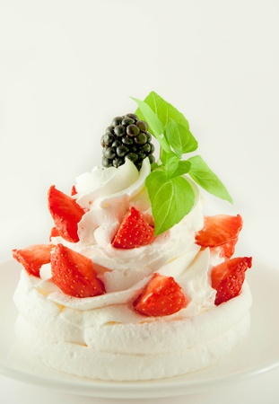 Cake from cream, strawberries and blackberries, a cup of fragrant coffee Stock Photo - 11377222