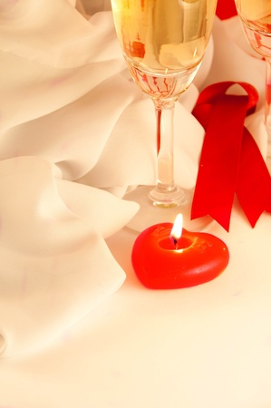 Celebratory table layout with red napkins and candles in the form of heart photo