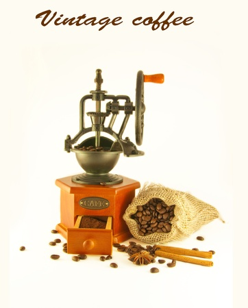 Coffee grinder in a retro style with a bag and coffee grains photo