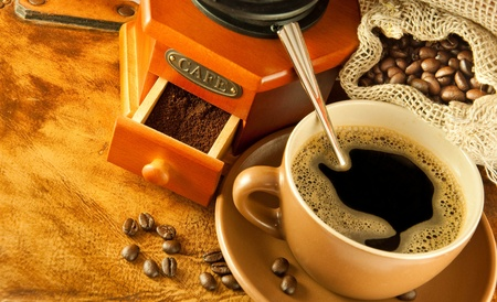 Coffee grinder in a retro style, a cup of coffee on grange background Stock Photo - 11662112