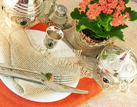 Table layout by table silver and natural flowers photo