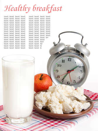 Milk, cottage cheese and alarm clock on the red napkin photo