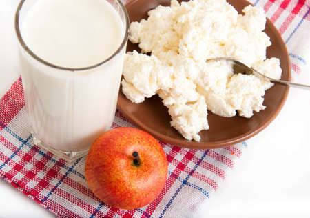 Milk, cottage cheese and apple on the red napkin photo
