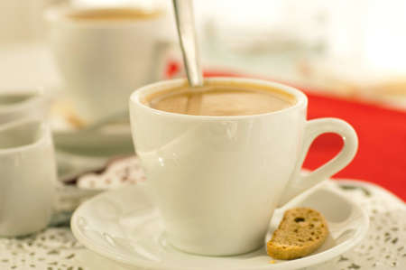 expresso: Cup of coffee with fragrant crouton on a red napkin
