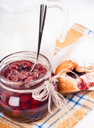 House jam and croissant with a cherry on a rasping napkin Stock Photo - 13106893