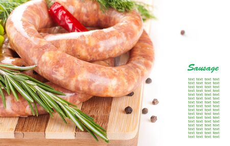 Sausage from pork and beef, tomatoes, salad and spices photo