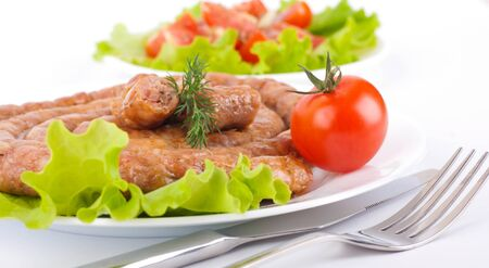 Sausage from pork and beef with tomatoes and spices, vegetable salad Stock Photo - 13106810