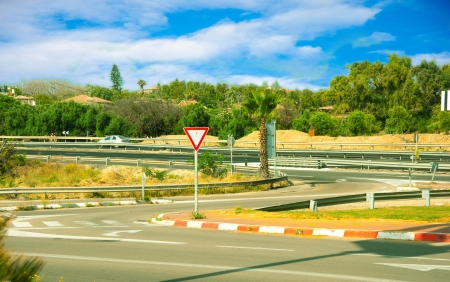The asphalted road and road signs in Israel photo