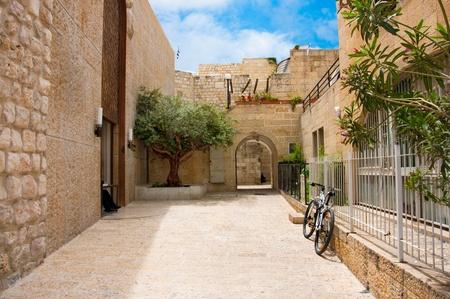 Narrow stone streets of ancient Jerusalem, Israel photo