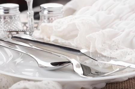 Table fork and knife in a napkin of medieval style photo