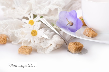 Table fork and knife in a napkin of medieval style, flower photo