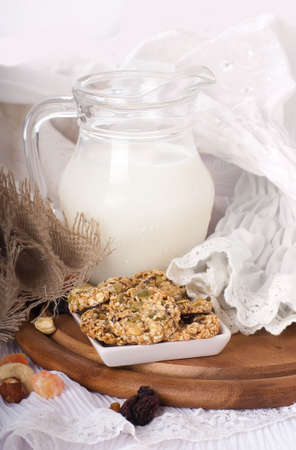 Jug with milk, bread on a white background photo