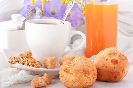 Breakfast from coffee with rolls, juice on delicate serviettes Stock Photo - 14054295
