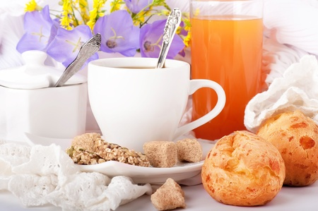 Breakfast from coffee with rolls, juice on delicate serviettes photo