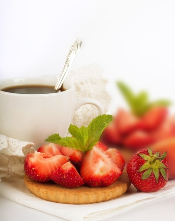 Strawberry with a mint and cup of coffee on a white background photo