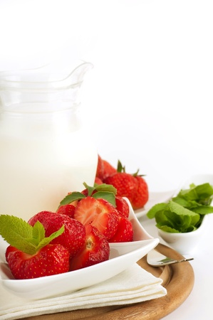 Strawberry with a mint and jug of milk on a white serviette Stock Photo - 14209147