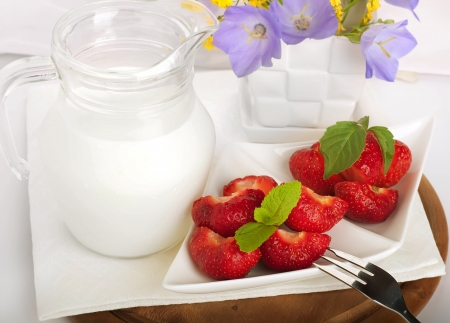 Strawberry with a mint and jug of milk on a white serviette Stock Photo - 14209194