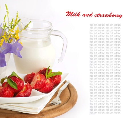 Strawberry with a mint and jug of milk on a white serviette photo